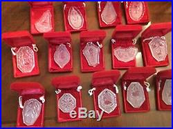 Waterford crystal ornaments 1978-1991. 14 Christmas designsall with cases